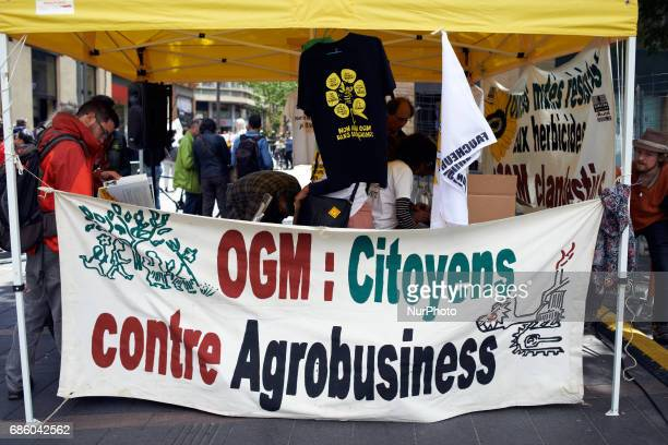A banner reading 'GMO Citizens against agrobusiness' on a stand before the beginning of the march against Monsanto People march in Toulouse for the...
