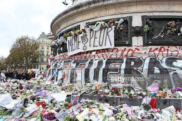 Banner reading in English 'We are not afraid' is seen at a makeshift memorial for the victims of the Paris terror attacks at Place de la Republique...