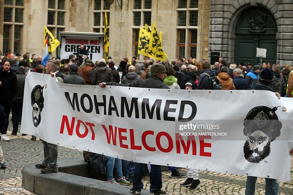 A banner reading 'Mohammed not welcome' with an editorial cartoon depicting Islam's prophet Mohammed a cartoon that was originally published by...