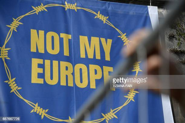 A banner reading 'Not my Europe' is hanged on the bank of the Tiber river during a symbolic protest of the civil society organizations against the...