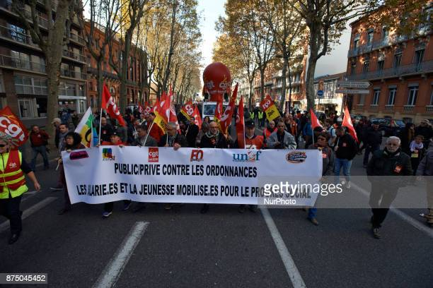 A banner reading 'Private/public against ordonnaces employees and youngs for social progress' More than 4000 protesters took to the streets of...