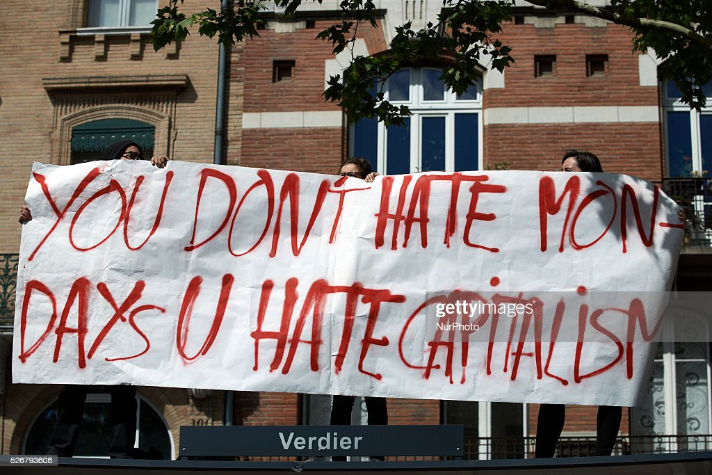 A banner reading 'You don't hate Mondays, you hate Capitalism' during the march for Labor Day. Toulouse. France. May 1st 2016.