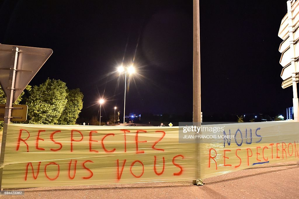 A banner reads 'Respect us we will respect you' outside the Lactalis group headquarters in Change near Laval northwestern France as part of a protest...