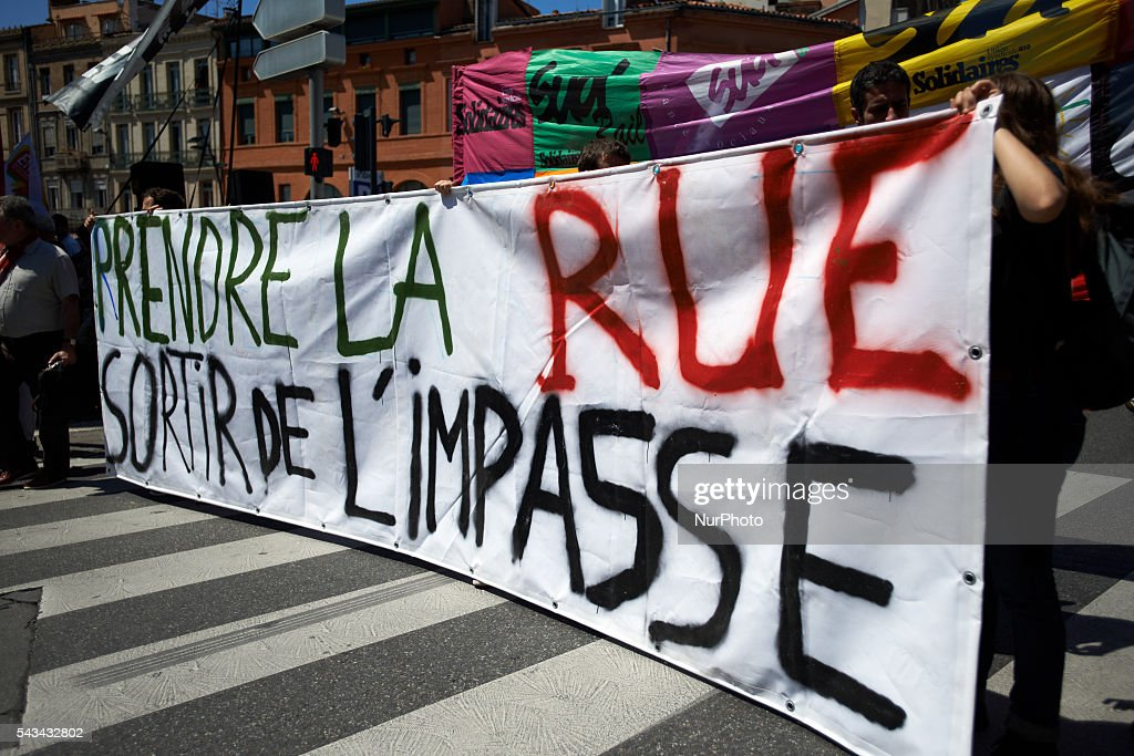 A banner reads 'Take the streets to get out the dead end' during a demonstration against the El-Khomri bill on labour reforms the day the bill go through the Senate. They also protest against the use of article 49.3 which bypass the Parliament . Toulouse. France. June 28th, 2016.