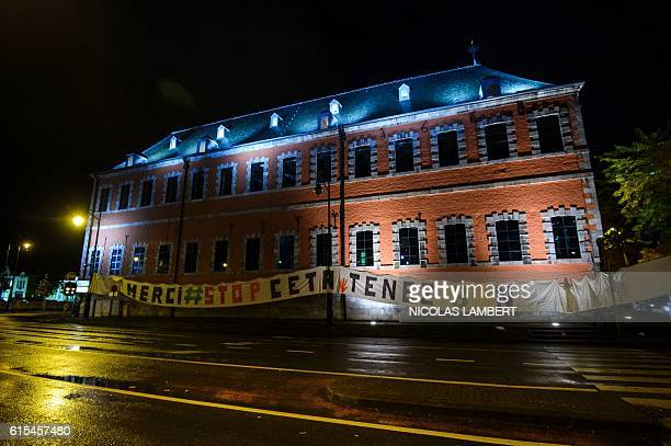 A banner reads 'Thank you stop CETA on the facade of the Walloon parliament building in Namur Belgium on October 18 2016 The European Union gave...