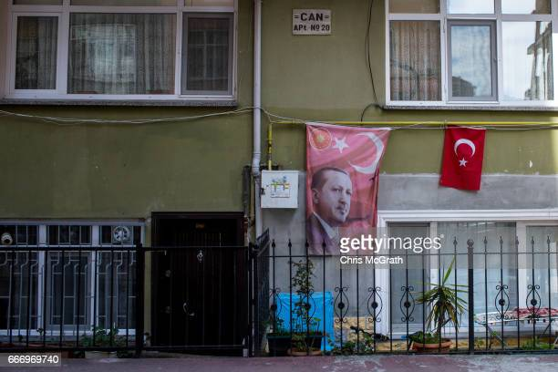 A banner showing the portrait of Turkish President Recep Tayyip Erdogan is seen hanging outside a house on April 10 2017 in Rize Turkey Although born...