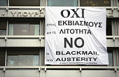 A banner supporting the NO vote in the upcoming referendum hangs from the offices of the Greek Finance Ministry on July 1 2015 in Athens Greece...