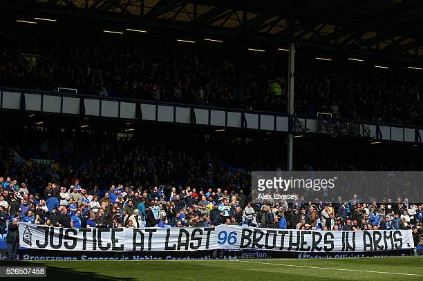 A banner to support the family members of the Hillsborough disaster victims are displayed prior to the Barclays Premier League match between Everton...