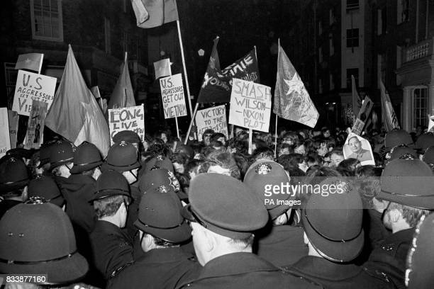 banner waving demonstrators meet a solid wall of policemen as they attempt to break through to Claridges London where the Anerican President was due...