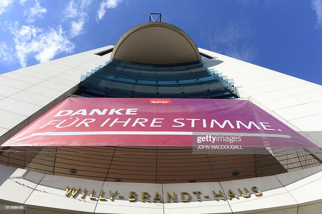 A banner which reads 'Thanks for your vote' hangs at the headquarters of the Social Democratic Party (SPD) on September 27, 2013. Germany's defeated opposition Social Democrats are meeting to debate overtures by Chancellor Angela Merkel for a 'grand coalition' government, with the centre-left party torn over the risks of accepting.