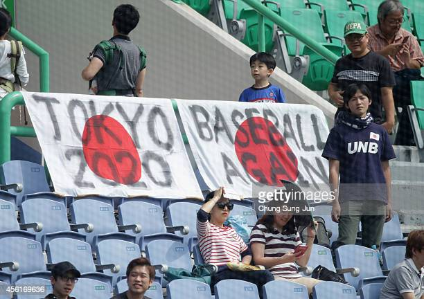 A banner wishing the return of the Baseball to the Olympic event hang during the Baseball Semifinal match between Japan and Chinese Taipei during day...