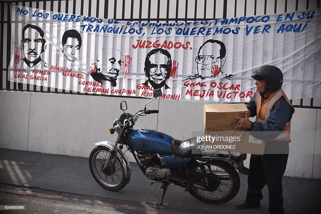 A banner with a portrait of former Guatemalan dictator Jose Efrain Rios Montt outside a court in Guatemala City on January 11 2016 A retrial of...