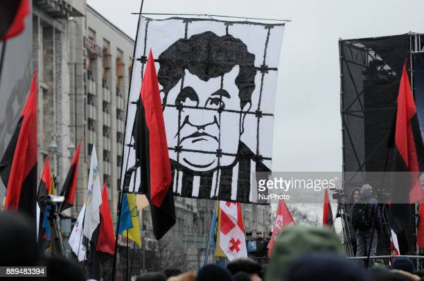 A banner with an illustration of incumbent president Petro Poroshenko dressed in prison overals is seen in Kiev Ukraine on December 10 2017 Several...
