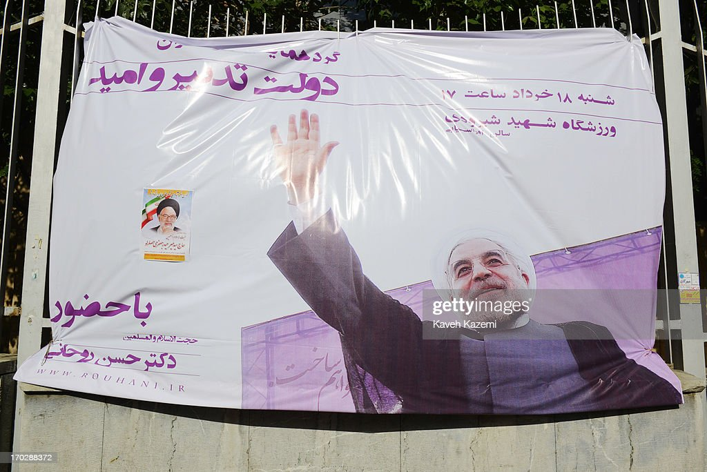 A banner with picture of Hassan Rowhani, one of the eight candidates approved to run for the Iranian presidency seen outside Shiroudi stadium on June 8, 2013 in Tehran, Iran. Iran is to go to the polls for the Iranian general election on June 14, 2013.
