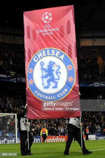 A banner with the Chelsea logo is paraded around the pitch prior to kick off