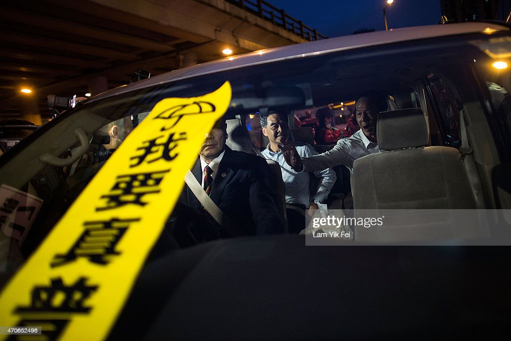 A banner with the Chinese characters 'I want real universal suffrage' placed by the prodemocracy protesters on a window of the vehicle in which Hong...