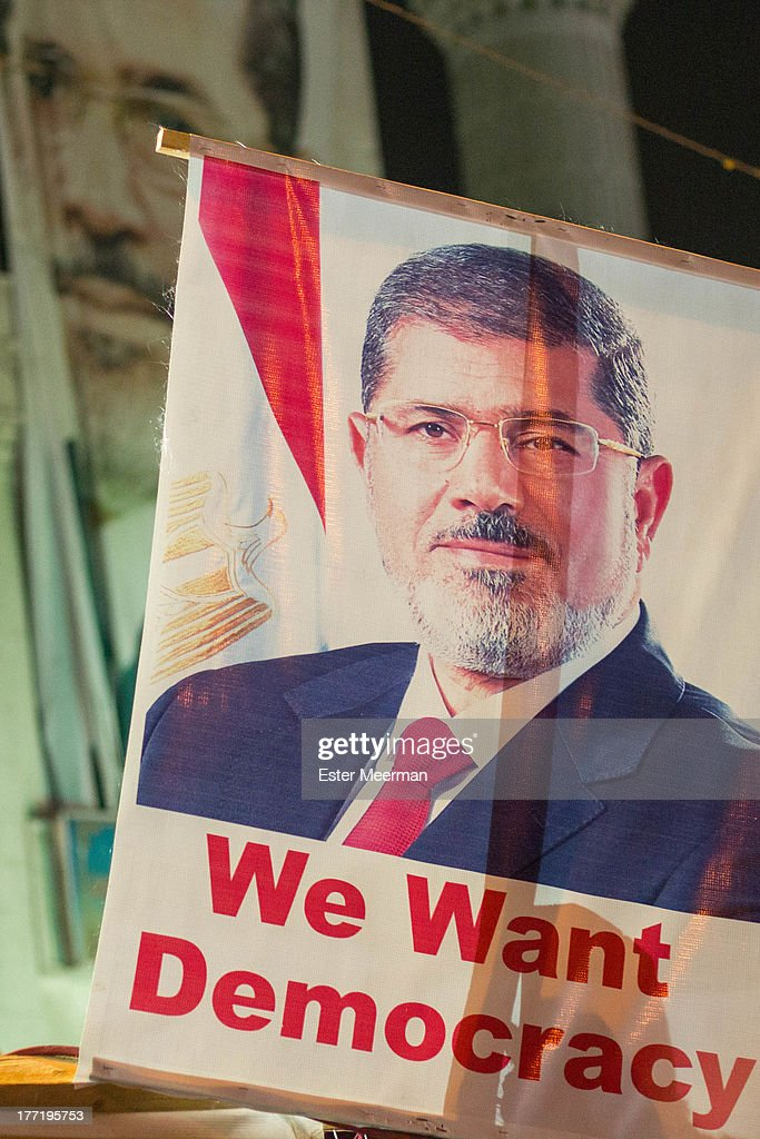 CONTENT] A banner with the image of deposed Egyptian president Mohammed Morsi is held up at the proMorsi sitin at the Rabaa Al Adaweyya mosque in the...