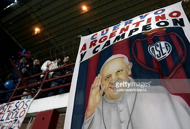 A banner with the image of Pope Francis hangs from a stand of Pedro Bidegain stadium in Buenos Aires Argentina on August 13 2014 during the Copa...