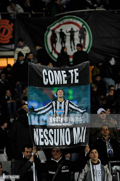 A banner with the logo of the Drughi Bianconeri a Juventus fan group and a fan holding up a benner in honour of Alessandro Del Piero