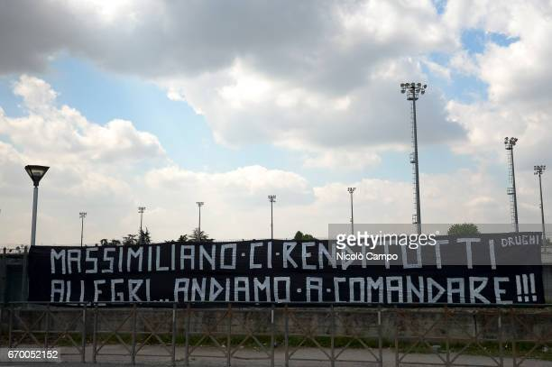 A banner written by fans of Juventus FC in support of coach Massimiliano Allegri is hanging out of the Juventus Training Center during a training...