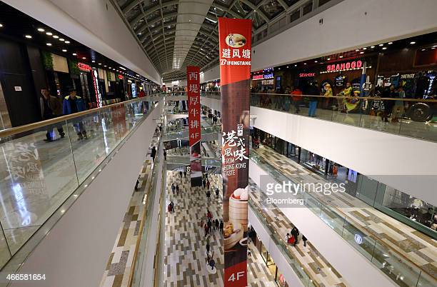 Banners advertising restaurants are displayed inside the Tongzhou Wanda Plaza shopping mall operated by Dalian Wanda Group Co in Beijing China on...