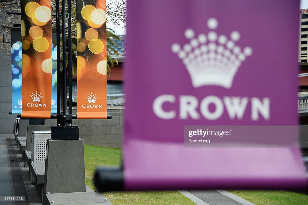 Banners advertising the Crown Melbourne casino and entertainment complex, operated by Crown Ltd., hang from lampposts near the property in Melbourne, Australia, on Wednesday, Aug. 21, 2013. Crown Ltd., the gaming company controlled by billionaire James Packer, is scheduled to announce full-year results on Aug. 23. Photographer: Carla Gottgens/Bloomberg via Getty Images
