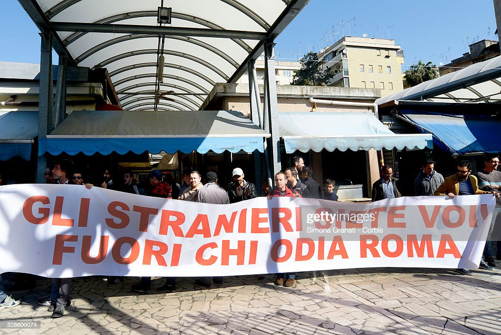 Banners are displayed as protests are made as Matteo Salvini, leader of the Northern League party makes a visit to Montagnola market in the southern district of the city on May 4, 2016 in Rome, Italy. Salvini abandoned his visit in the face of anti-racist protests.