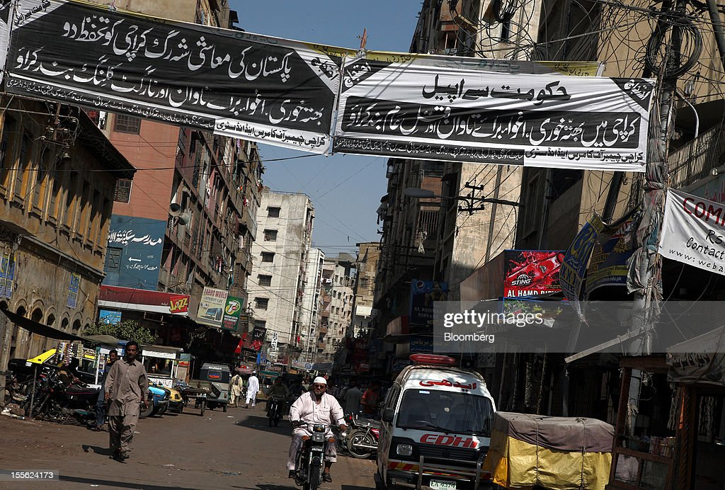 Banners arranged by the Karachi Chamber of Commerce and Industry condemning extortion, target killing and kidnapping for ransom are displayed in a residential area in Karachi, Pakistan, on Tuesday, Oct. 30, 2012. Businesses in Pakistan's commercial capital are bracing for a surge in extortion demands as parties representing the city's ethnic communities seek to use their hired guns to build financial war chests ahead of parliamentary polls due in the first half of next year. Photographer: Asim Hafeez/Bloomberg via Getty Images