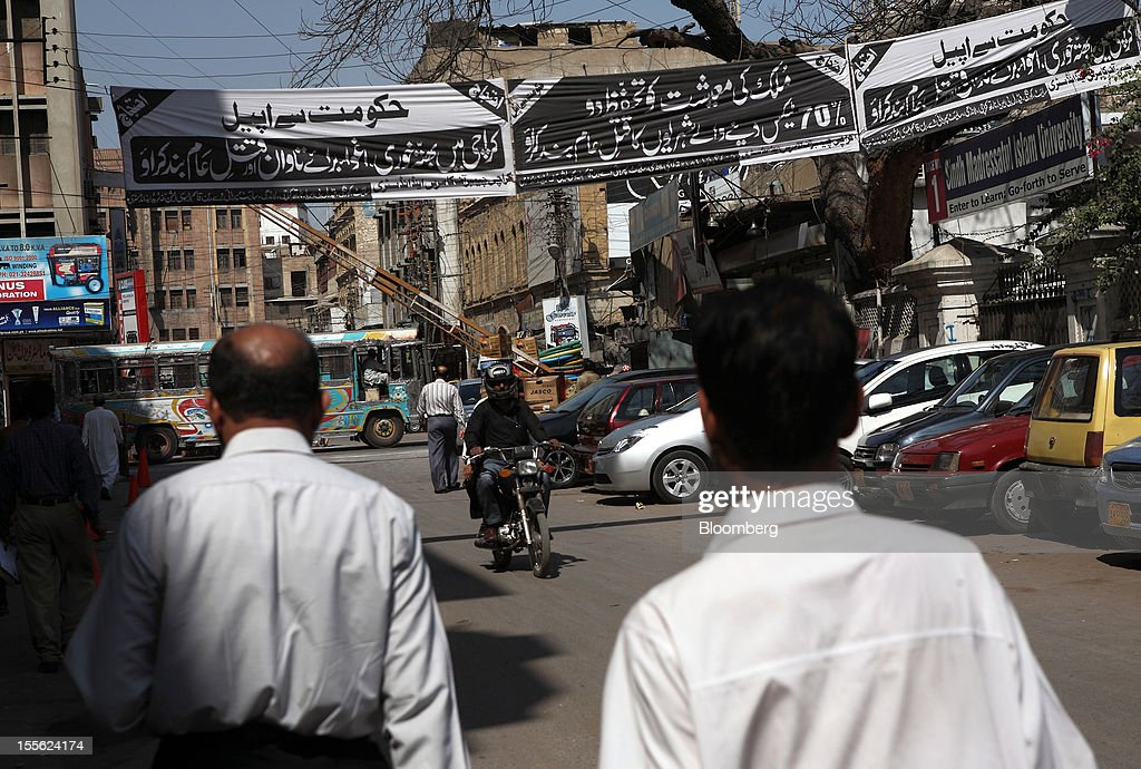 Banners arranged by the Karachi Chamber of Commerce and Industry condemning extortion, target killing and kidnapping for ransom are displayed in the business and financial hub in Karachi, Pakistan, on Tuesday, Oct. 30, 2012. Businesses in Pakistan's commercial capital are bracing for a surge in extortion demands as parties representing the city's ethnic communities seek to use their hired guns to build financial war chests ahead of parliamentary polls due in the first half of next year. Photographer: Asim Hafeez/Bloomberg via Getty Images