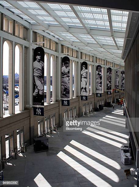 Banners featuring Yankee greats old and new hang within the openair Great Hall of the new Yankee Stadium in the Bronx borough of New York US on March...