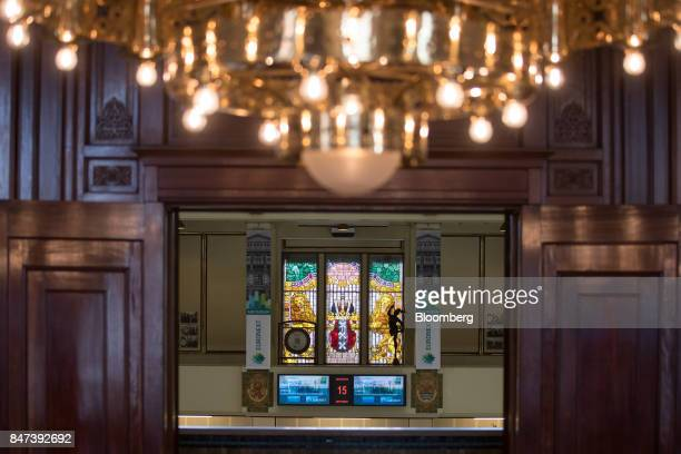 Banners hang beside a stained glass window inside the Amsterdam Stock Exchange operated by Euronext NV in Amsterdam Netherlands on Friday Sept 15...