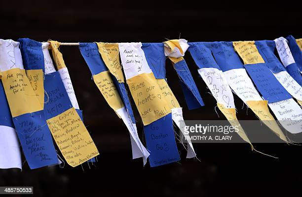 Banners hang from the Trinity Church near the finish line on the eve of the 2014 Boston Marathon April 20 2014 in Boston Massachussetts The Boston...