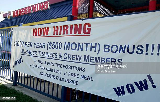 Banners hang outside a Burger King resturant offering new employees a $6000 signing bonus on October 5 2005 in Metairie Louisiana Hurricane Katrina...