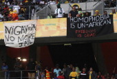 Banners in protest at the AntiGay Marrage Law recently passed in Nigeria are displayed in the crowd during the 2014 African Nations Championship...
