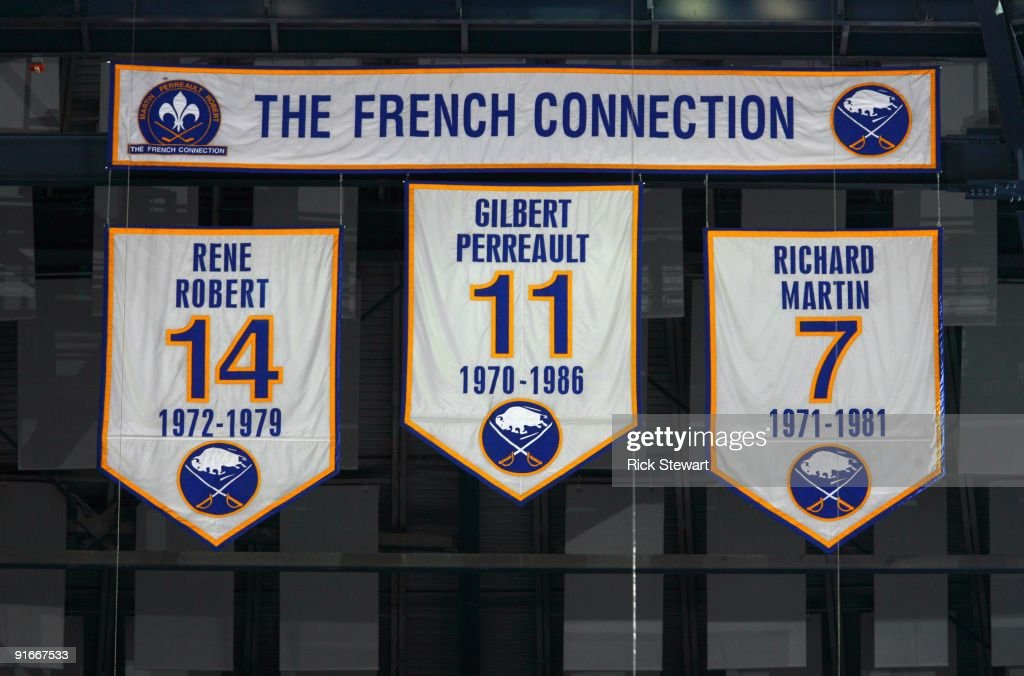 Banners of the numbers of the former Buffalo Sabres 'French Connection' line of Rene Robert Gilbert Perreault and Richard Martin hang from the...