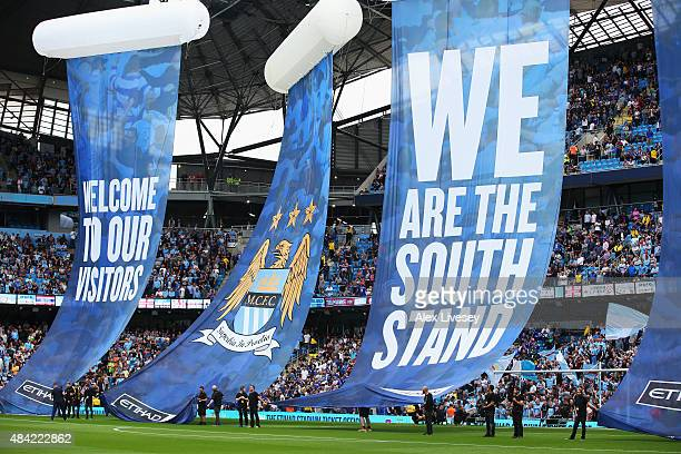 Banners present the newly developed south stand during the Barclays Premier League match between Manchester City and Chelsea at the Etihad Stadium on...