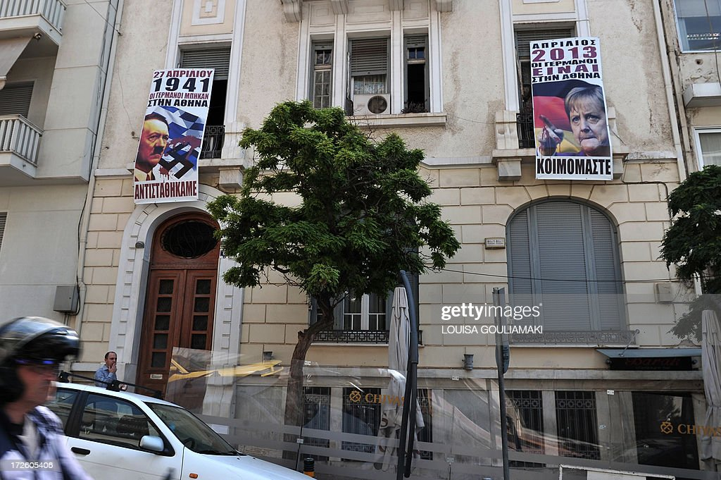Banners reading 'April 1941 - Germans entered Athens - we resisted' (L) and 'April 2013 - Germans are in Athens - we sleep' hang on a building clsoe to the German embassy in Athens on July 4, 2013. Greek officials said today they were close to a deal with the country's EU-IMF creditors which would win approval for the next slice of eurozone loans next week. Uncertainty over the outlook for the Greek debt-rescue programme had begun to worry financial markets in the last few days. AFP PHOTO/ LOUISA GOULIAMAKI