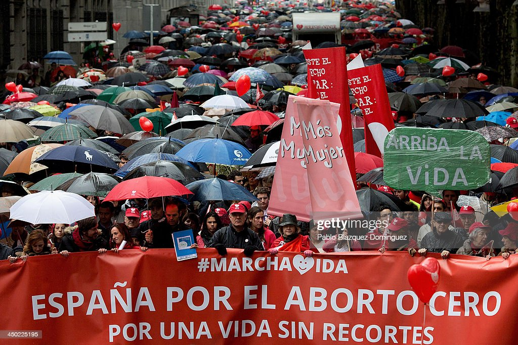Banners reading 'Spain Zero Abortion, For A Life Without Cuts' are held aloft amongst a crowd of protestors during a Pro-Life demonstration against abortion on November 17, 2013 in Madrid, Spain.