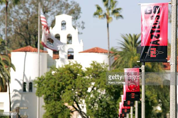 Banners supporting the San Diego State Aztecs hang from light poles lining the walkway in front of Hepner Hall on the SDSU campus before the game...