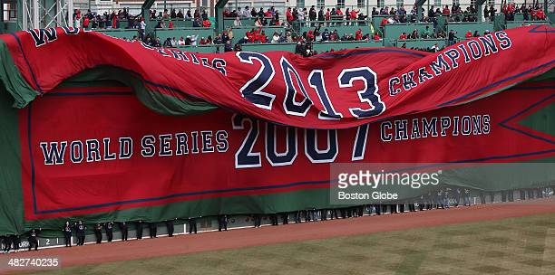 Banners were unfurled on the Green Monster commemorating each of the Red Sox's World Series championships The Boston Red Sox held a pregame ceremony...