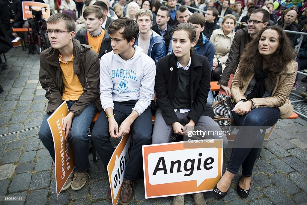 Banners with the written letters 'Angie', a nickname of German Chancellor and Chairwoman of the German Christian Democrats (CDU) Angela Merkel lies on the legs of supporters during CDU election campaign rally on September 15, 2013 in Dresden, Germany. Merkel has a strong lead over her political rivals and the CDU is expected to win federal elections scheduled for September 22