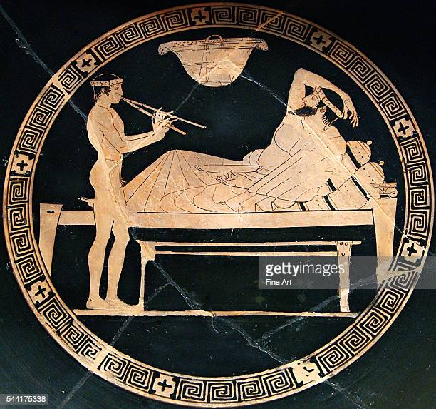 man reclining on a bench and youth playing the aulos Tondo of an Attic redfigure cup circa 460 BC450 BC Dimensions diameter 311 cm Located in the...