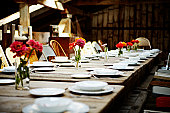Banquet table set for dinner inside building