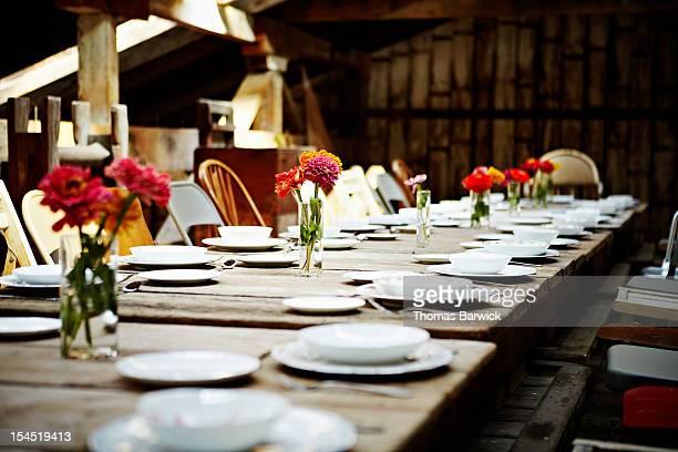 Banquet table set for dinner inside building