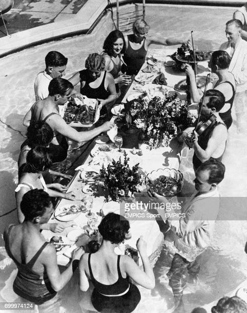 A banquet was given in the Huntingdon Pool at Pasadena California in honour of the world record breaking Women's relay team the banquet was floating...
