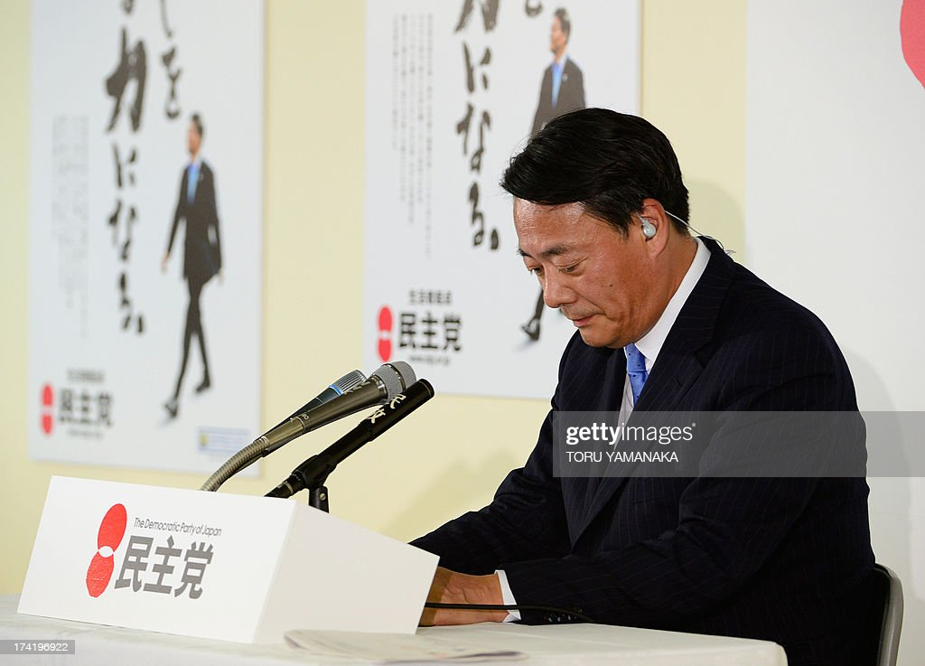 Banri Kaieda, head of the main opposition Democratic Party of Japan (DPJ), bows to acknowledge defeat during TV interviews for the upper house election of parliament at the DPJ headquarters in Tokyo on July 21, 2013. Voters gave Prime Minister Shinzo Abe a resounding victory in upper house elections Sunday, exit polls showed, likely ushering in a new period of stability for politically volatile Japan. AFP PHOTO/Toru YAMANAKA