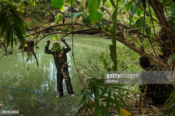 Banser recruit crosses a river on a rope during a three day induction course on July 23 2017 in Kebumen Indonesia Banser the security unit of...