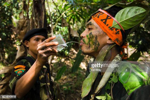 Banser recruit gets a sip of water from an instructor after climbing a hill during a rigorous three day induction course on July 23 2017 in Kebumen...