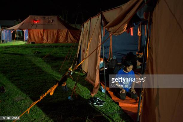 Banser recruit prays in his tent during a rigorous three day induction course on July 21 2017 in Kebumen Indonesia Banser the security unit of...