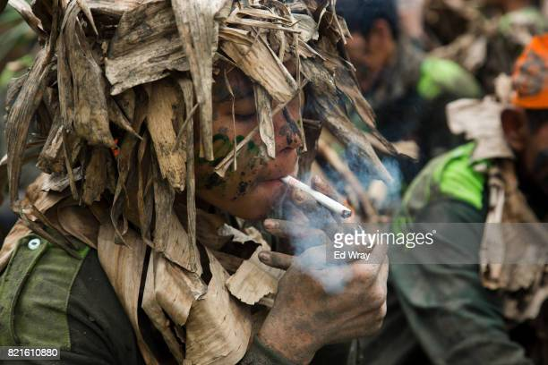 Banser recruit takes a smoke break during a rigorous three day induction course on July 23 2017 in Kebumen Indonesia Banser the security unit of...